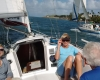 Picture of guests sitting in cockpit of sailboat racing another sailboat under sails in San Juan Bay, Puerto Rico.