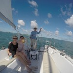 Picture of passengers seated in large cockpit of our Beneteau First Class 10 sailboat used for daysailing.